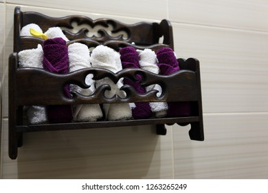small hand towels on wooden shelf