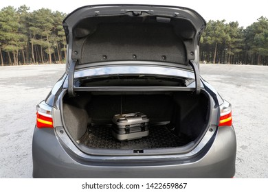 small handbag in car trunk
