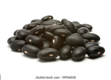 A small handful of black beans - preto. Beans isolated on a white background. Close-up.