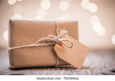 Small handmade gift boxes in shiny lights background