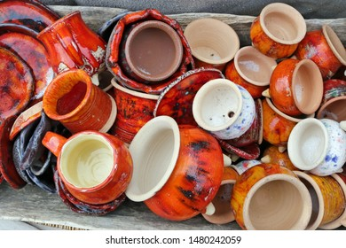 Small  handmade rural ceramic  jugs and cups sold  on a street. Snapshot style image
