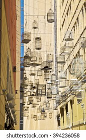 small hanged birds Cages on the street , buildings ,architectural  ,sydney , house  ,between    ,black ,yellow ,empty, up ,decorations