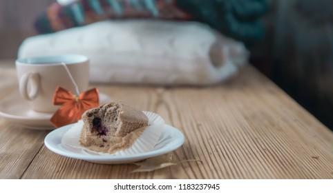 Small happiness concept, sad image with tea and cake