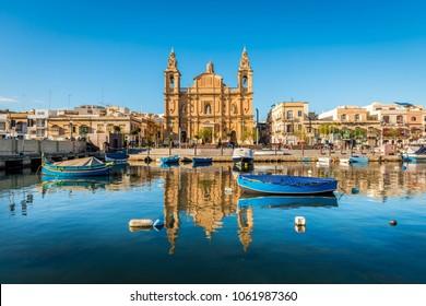 Small harbor and baroque church in Sliema, on the island of Malta
