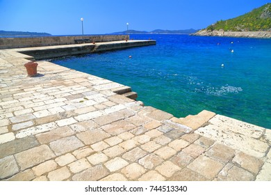 Small harbor on the shore of the Adriatic sea, Trsteno, Croatia