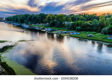 Small harbor and view to the Ada bridge on the river Sava in Bel