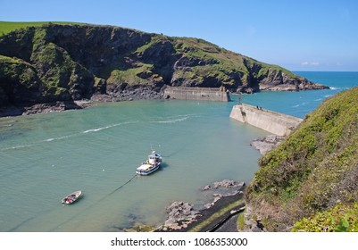 The small harbour of Port Isaac on a sunny day, - a small and picturesque fishing village in Cornwall, England