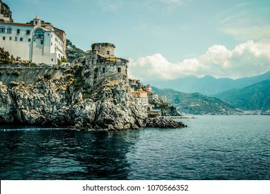 Small haven of Amalfi village with tiny beach and colorful houses, located on rock, Amalfi coast with Gulf of Salerno, Campania, Italy.