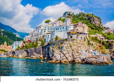 The small haven of Amalfi village with the tiny beach and colorful houses, located on the rock, Amalfi coast, Italy