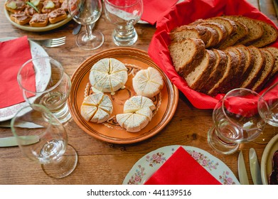 small heads of goats Camembert cheese in the bowl with mold