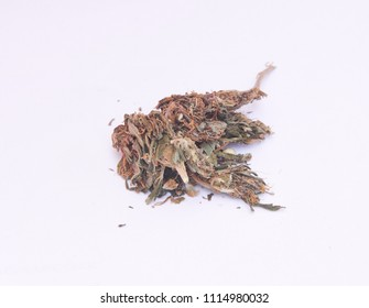 A small heap of low quality cannabis, other known as bush-weed.