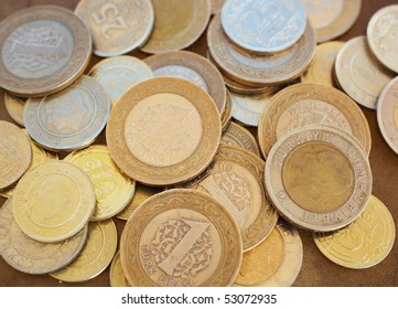A Small heap of turkish coins on a smooth brown leather sheet