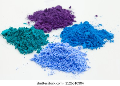 small heaps of color powder - studio light