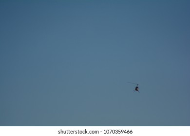 Small helicopter with blue sky in the background