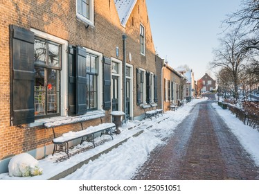 Small historic Dutch village covered with snow.