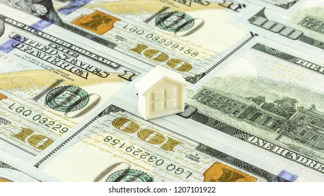 small home on the pile of banknotes.