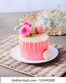 A small homemade cake with pink frosting for a special occasion