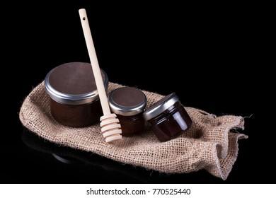 Small Honey jars on a black background