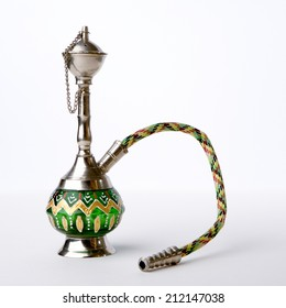 A small hookah pipe, also known as a shisha, isolated against a white background.