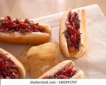 Small Hot Dogs served with Mix of Carrot Cole Slaw and Plain Chips
