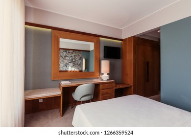 Small Hotel room interior with blue colours wall, wooden elements in design