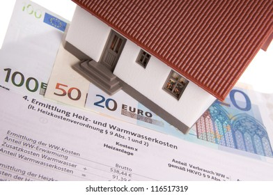 small house with banknotes and Charges Settlement / heating coasts