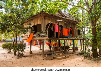 a small house of Buddhists in Asia on stilts, in a monastery near a Buddhist temple