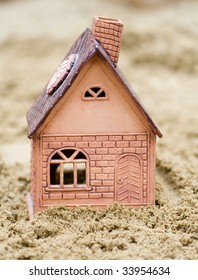 The small house from clay in sand