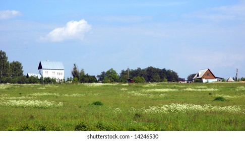 Small house in the distance on a meadow