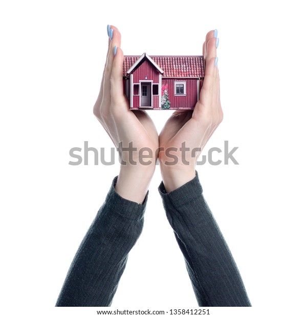 Small House Hand On White Background Stock Photo Edit Now 1358412251
