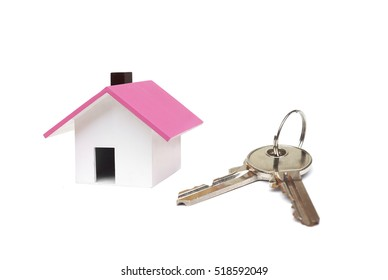 A small house and a key / Buying a house concept