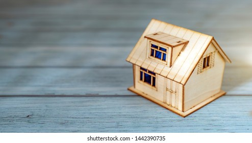 Small house model on wooden background