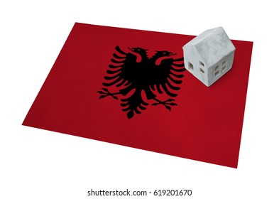 Small house on a flag - Living or migrating to Albania