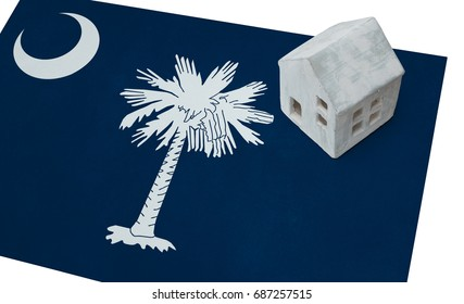 Small house on a flag - Living or migrating to South Carolina