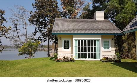 small house on greensward.