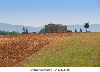 A small house on the plowed land - Landscape of Tuscany