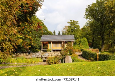 Small house and pond in Japanese style in the garden. Japanese garden.