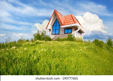 small house with red roof on a sunny hill