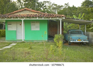 Small houses in front of limestone mountains in the Valle de Viatales, in central Cuba
