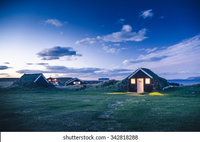 small houses in Iceland, grass on the roofs