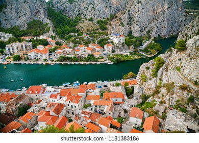 small houses on the both sides of river Cetina in town Omis, Makarska Riviera, Croatia
