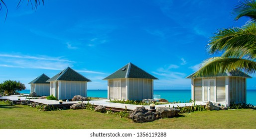 Small houses on a tropical ocean shore