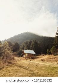 A small hut in the mountain. Pirin mountain, Bulgaria. Hut Yavorov. Mountain refugee.