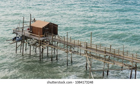 Small hut on poles in the ocean