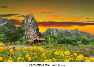 the small hut Thai stay and rocky mountain background.