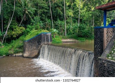 Small hydroelectric dam on the river in tropical forest on Bali, Indonesia