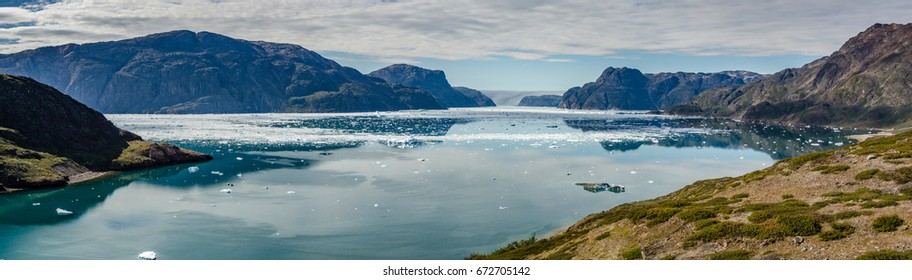 Small icebergs and reflections near a glacier, Greenland