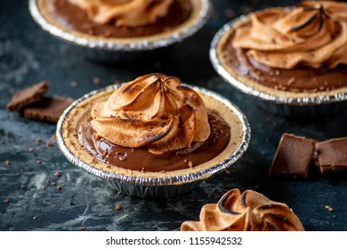 small individual chocolate pudding pies with toasted meringue tips