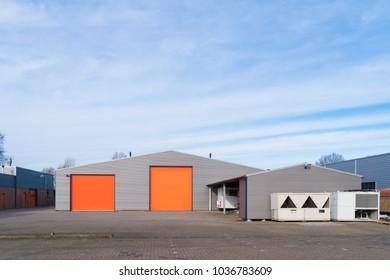 small industrial warehouse with orange roller doors