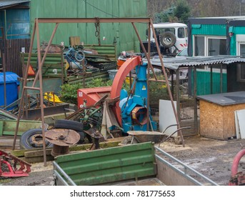 small iron junk yard scrap heap  with colorful old rusty metal tools